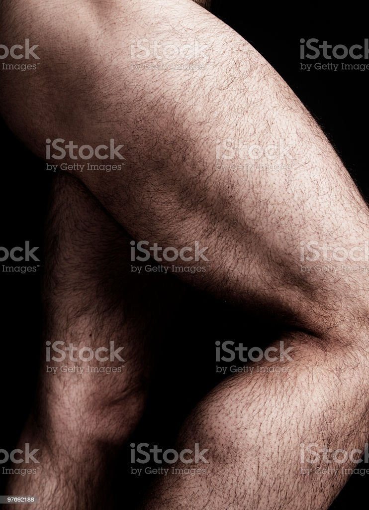 Desaturated close-up of hairy muscular legs royalty-free stock photo