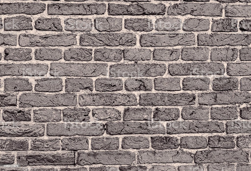 Desaturated old, brick wall texture stock photo
