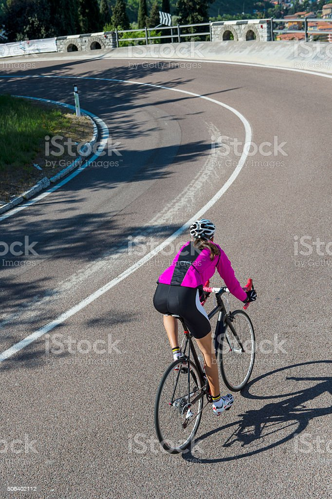 descending by road cycle in a curve stock photo