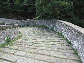 Descent stone walkway of medieval bridge
