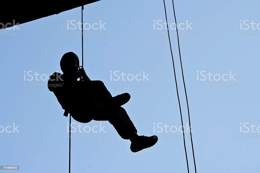 Descenting with rope stock photo