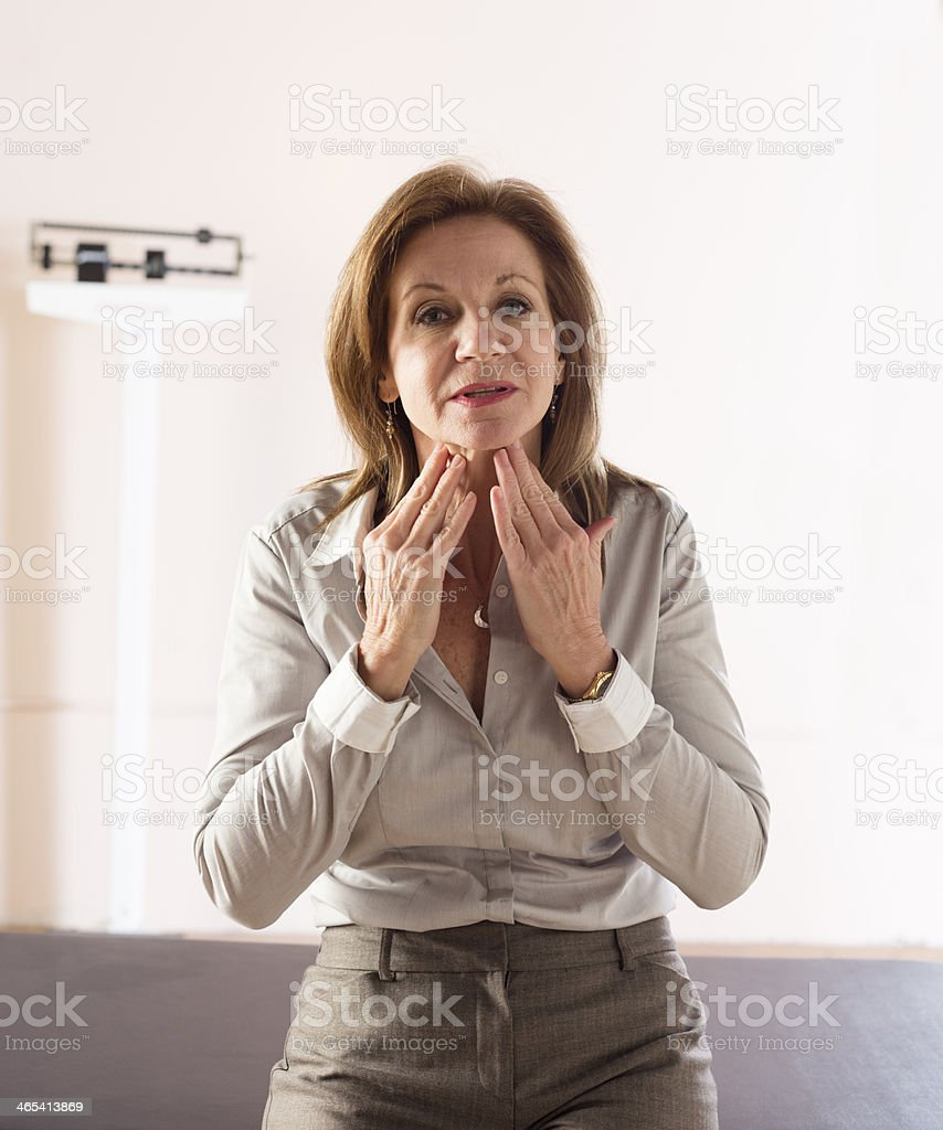 Describing symptoms in a doctor's office royalty-free stock photo