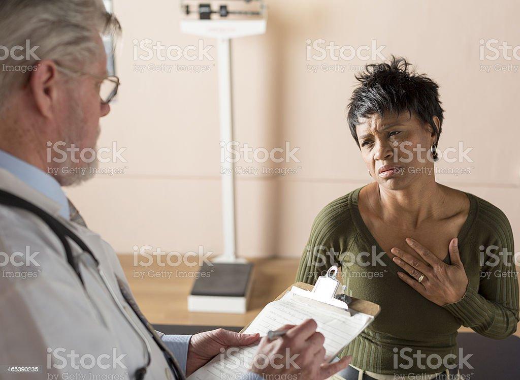Describing symptoms to a doctor stock photo