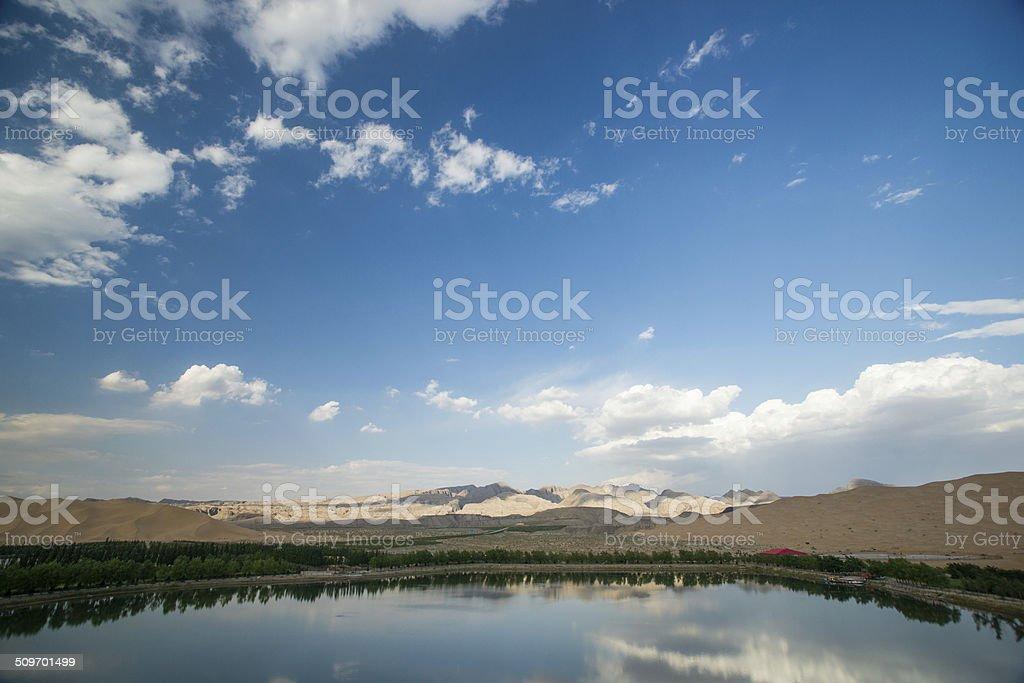 desert and lake scenery stock photo