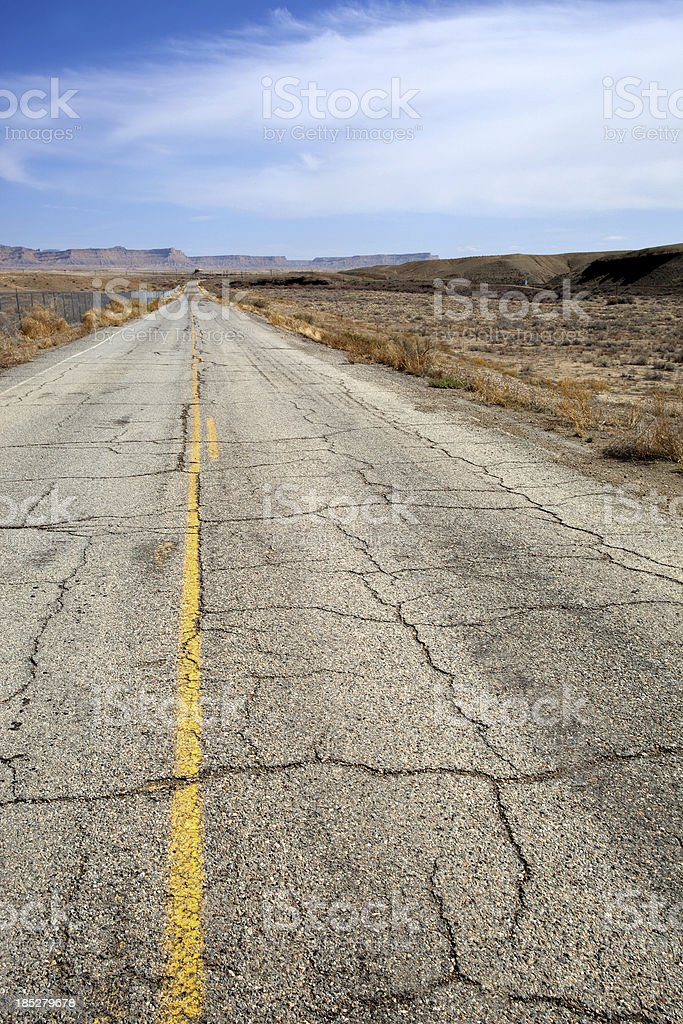 desert badlands road trip landscape stock photo