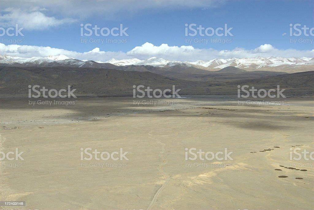 Desert before Gandise mountain range (Ngari, Tibet) royalty-free stock photo