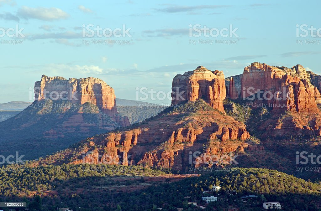 Desert canyons in front of a blue sky stock photo
