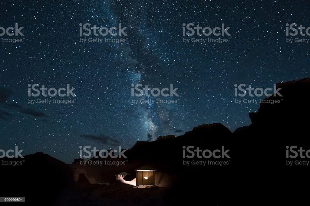Desert canyons with milky way stars at night stock photo