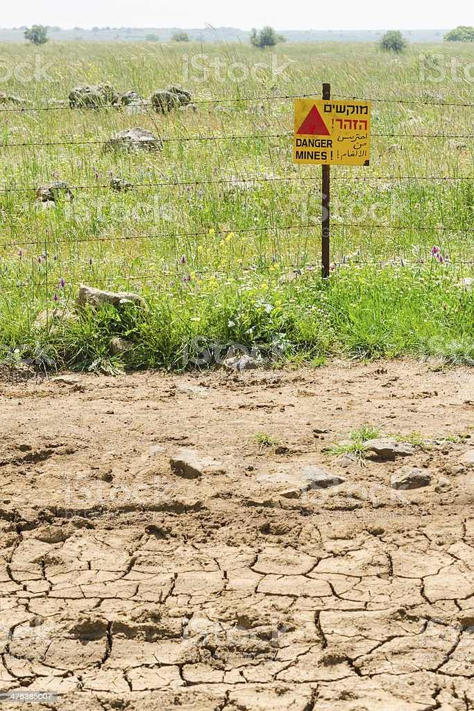 Desert dried land and quiet green mines field stock photo