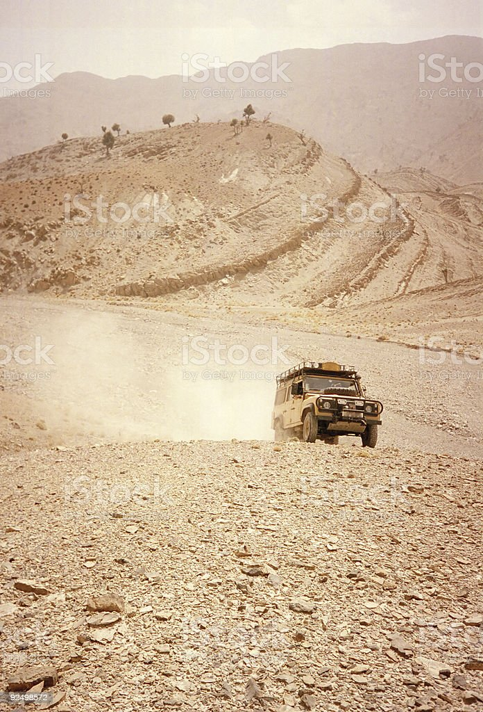 desert driving morocco land rover royalty-free stock photo