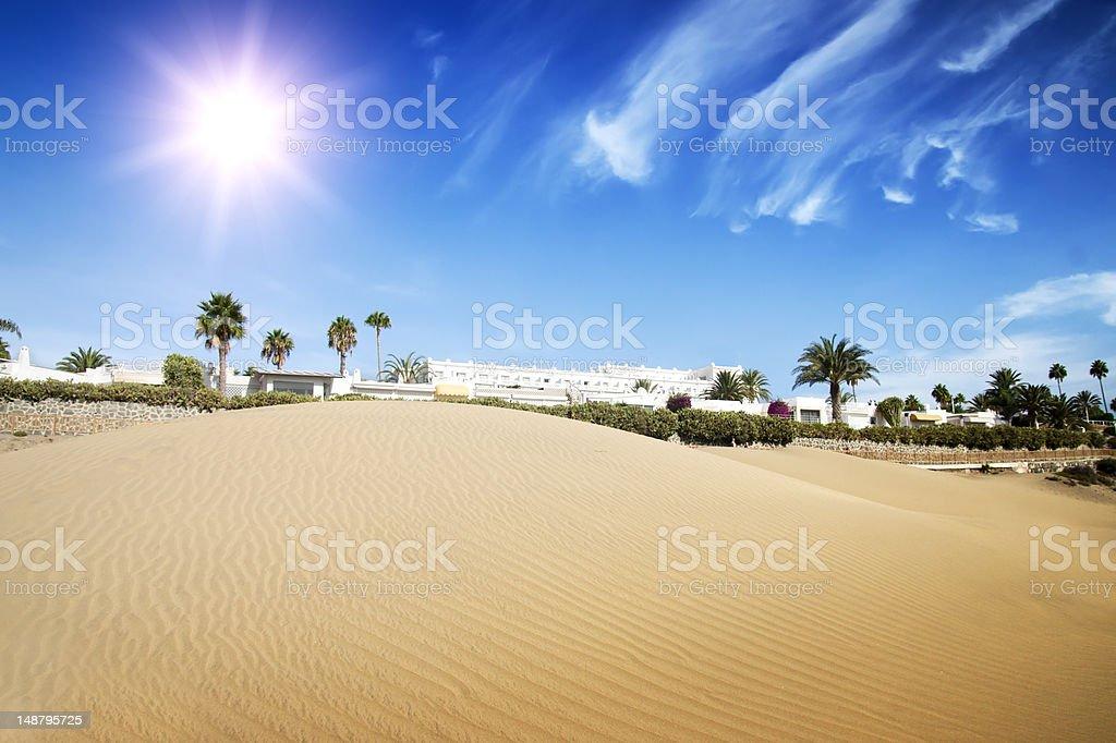 Desert dunes hotel in sunset. stock photo