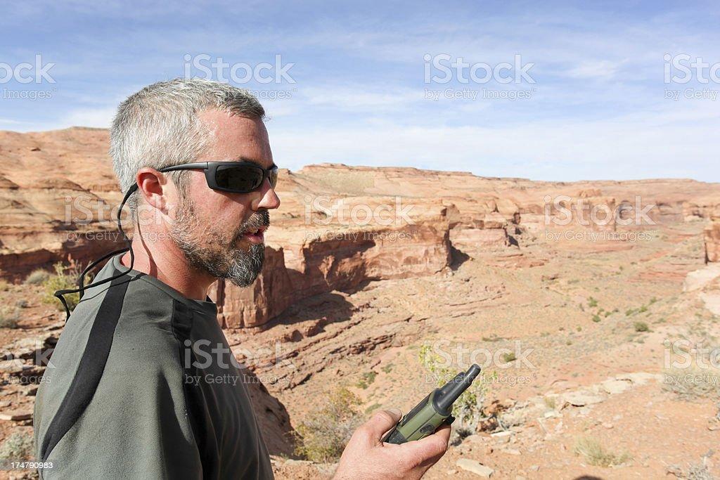 desert explorer with GPS unit royalty-free stock photo