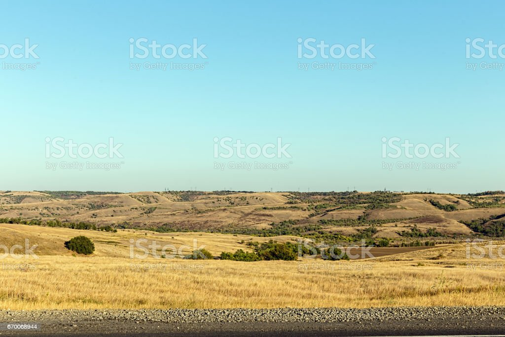 Desert. Hills covered with scattered trees stock photo