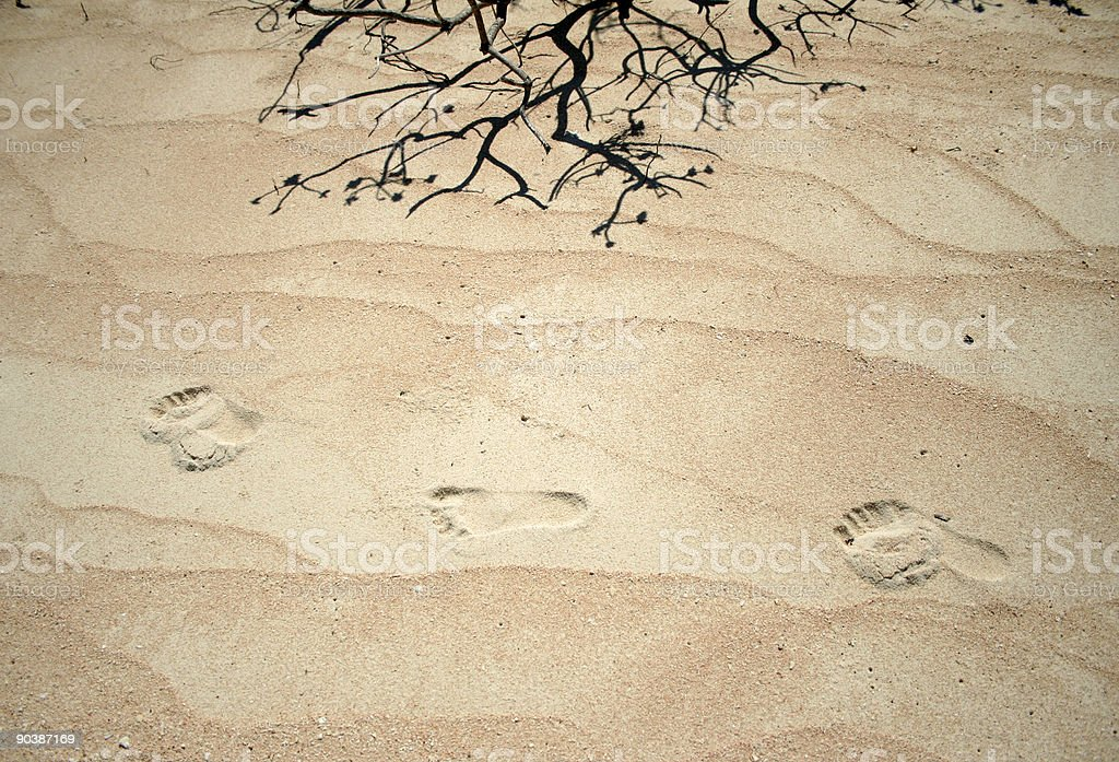 desert island footprints in the sand background royalty-free stock photo