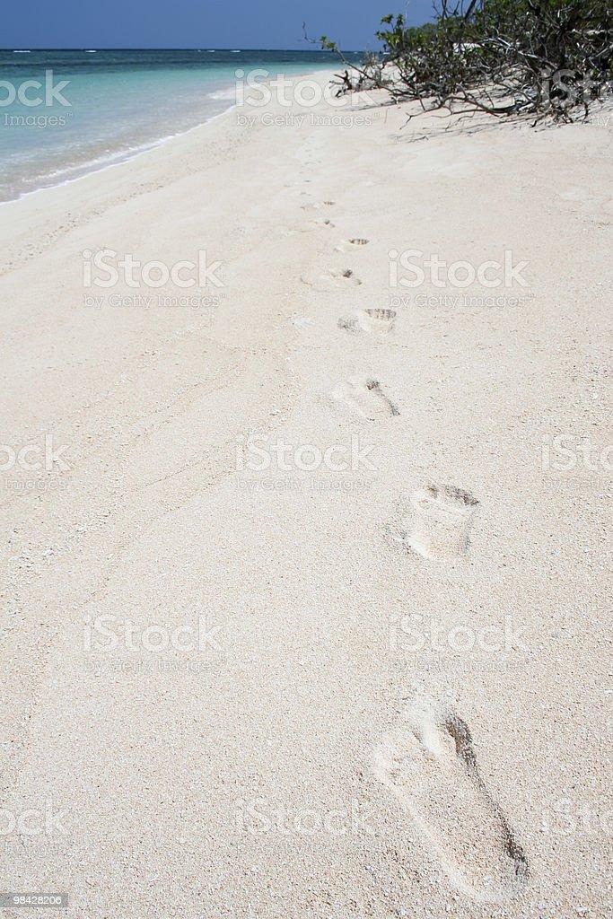 desert island footprints on white sand beach royalty-free stock photo