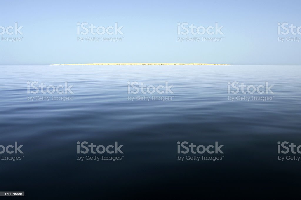 Desert Island on Open Sea royalty-free stock photo