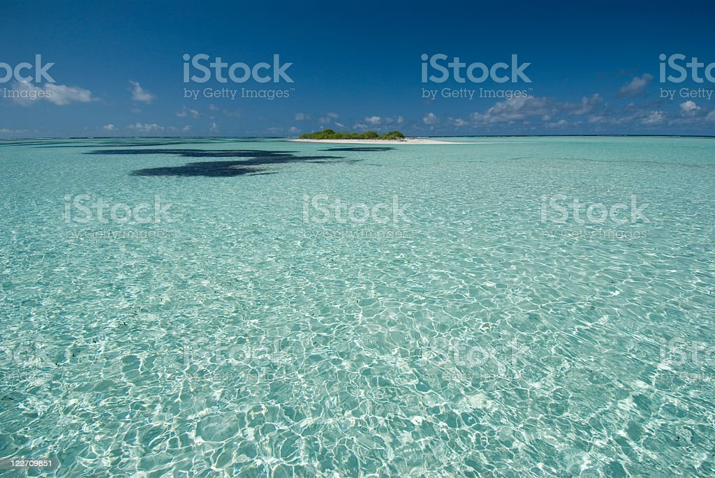 desert island surrounded by clear water royalty-free stock photo
