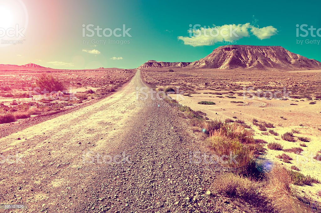 Desert landscape and road.Sunset scenic stock photo