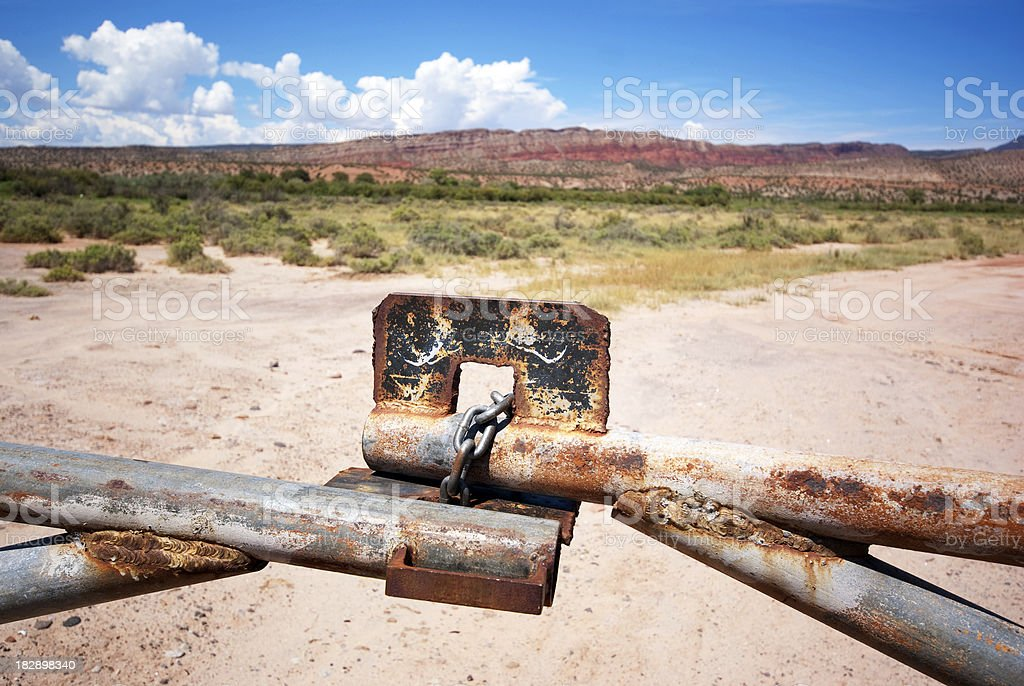 desert landscape locked gate stock photo