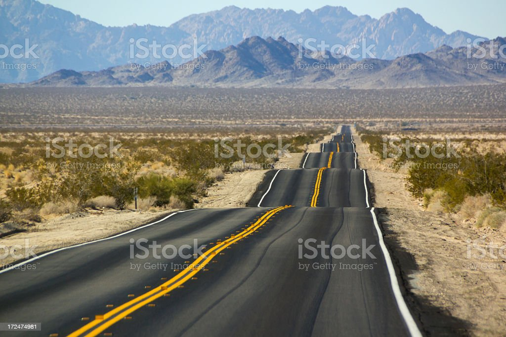 Desert Landscape with bumpy road stock photo