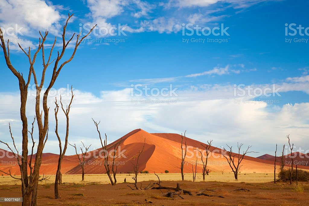 Desert mountain and plain against beautiful blue sky stock photo