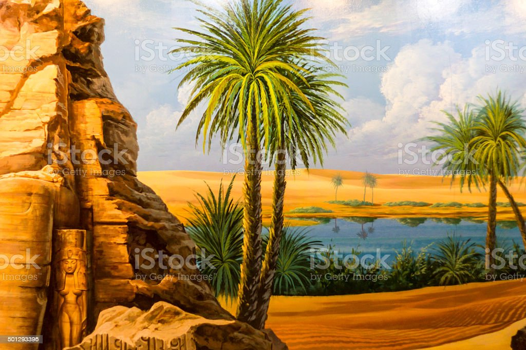 Desert oasis and palm trees stock photo