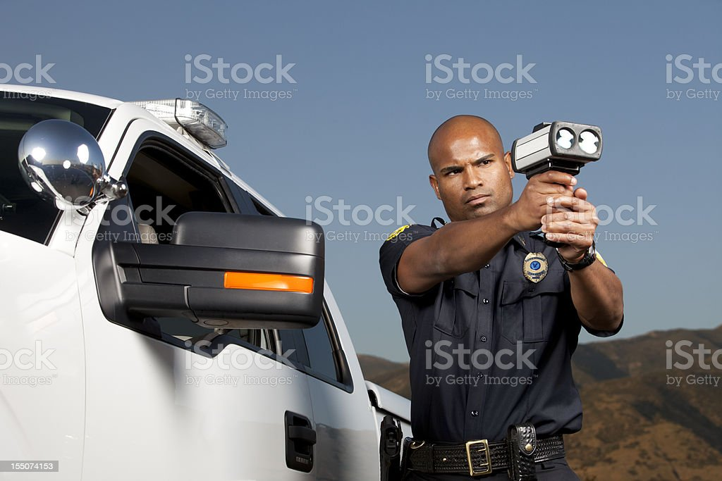Desert Patrol Agent with a Radar Gun stock photo