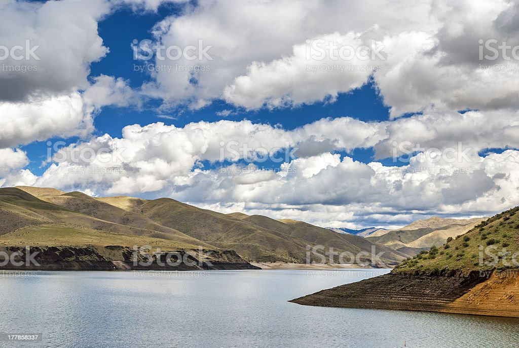 Desert Reservoir and fantastic clouds royalty-free stock photo