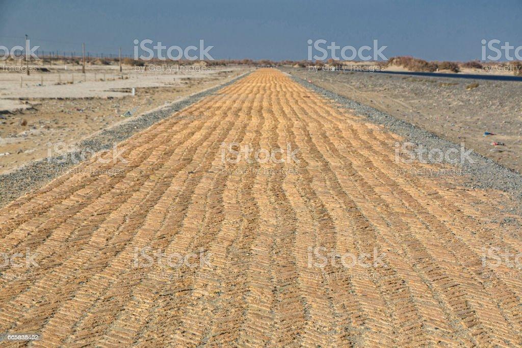 Desert road, brick laying stock photo