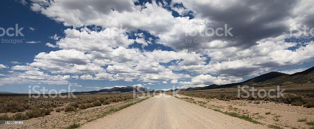 Desert Road, Cloudy Sky stock photo