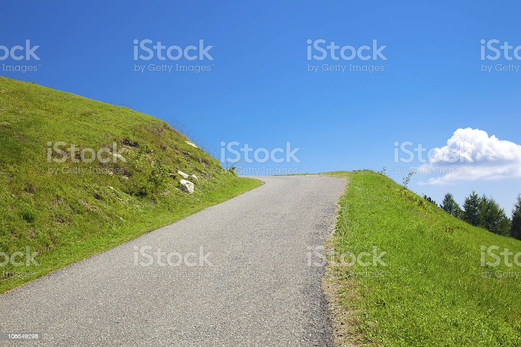 Desert road through the hills royalty-free stock photo