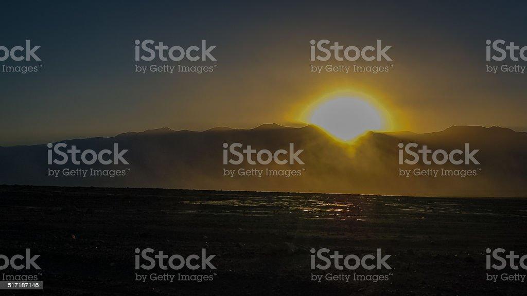 Desert sandstorm at sunset in Death Valley National Park stock photo
