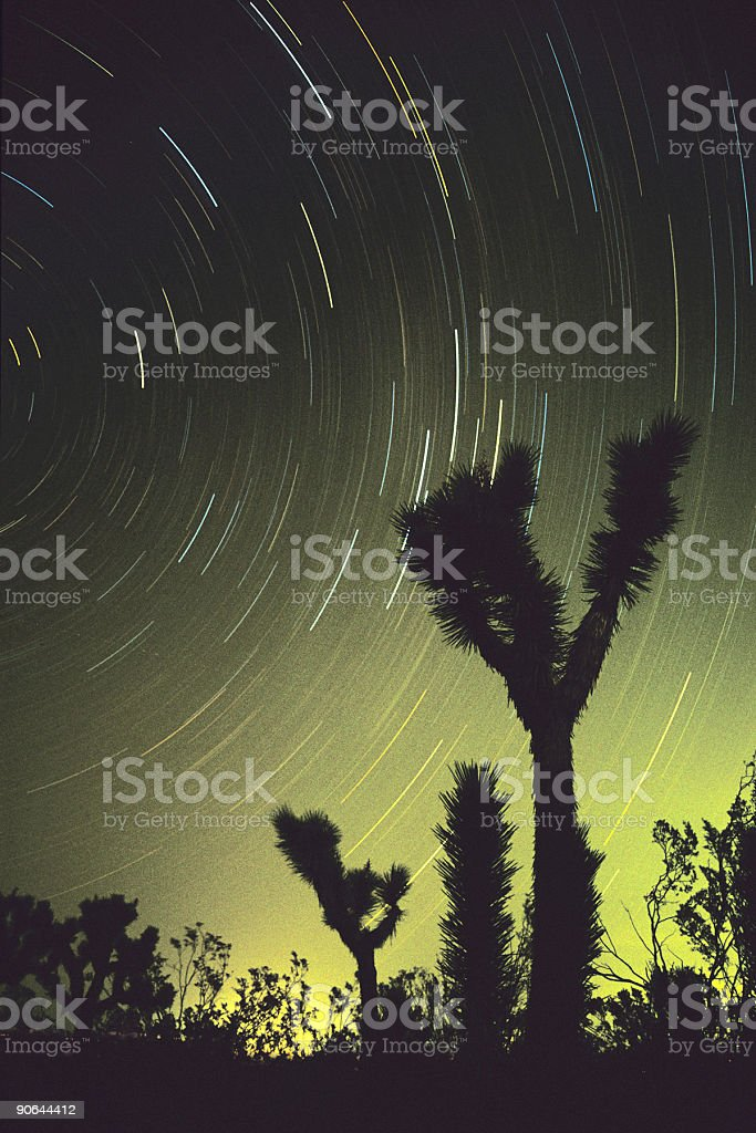 desert star contrails stock photo
