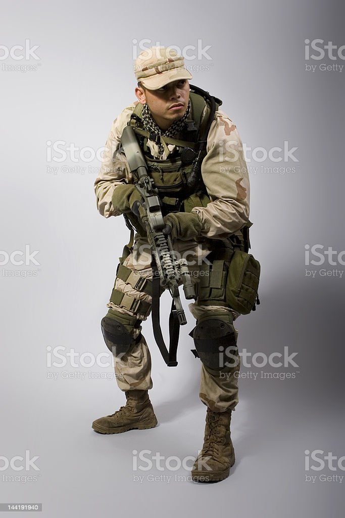 desert storm army soldier crouched royalty-free stock photo