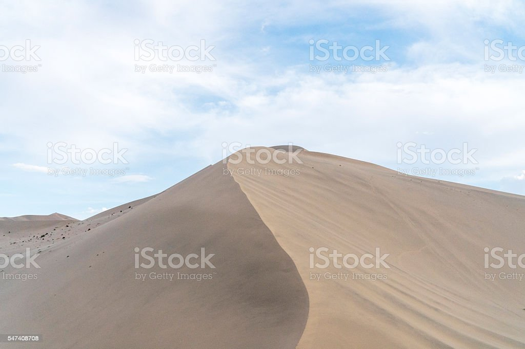 desert under cloudy sky stock photo