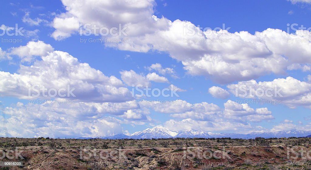 Desert valley, distant mountains, clouds in winter royalty-free stock photo