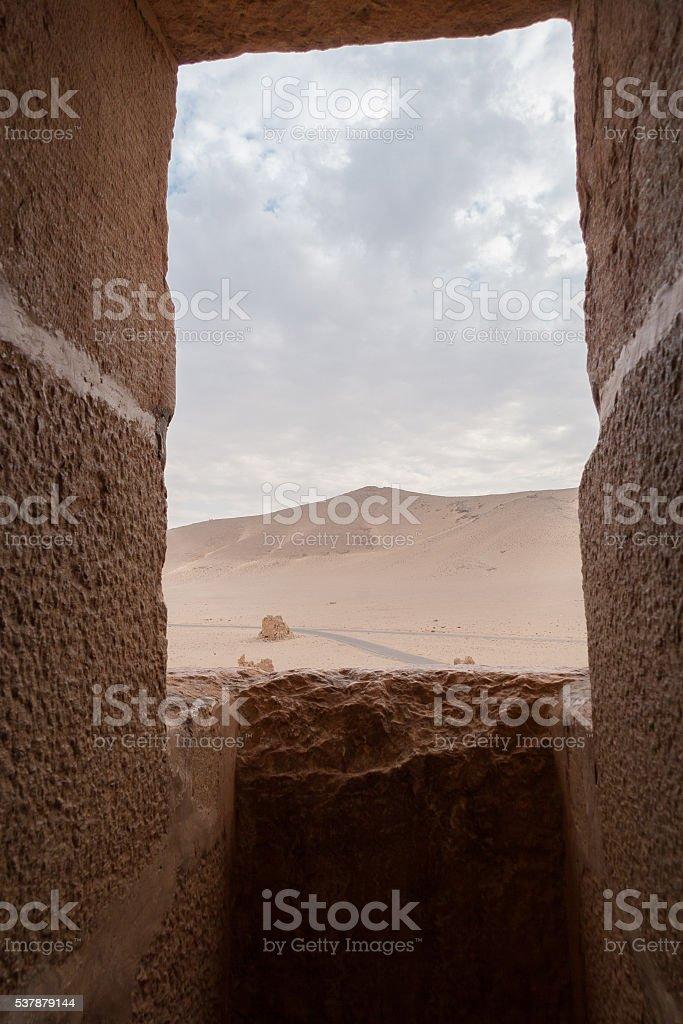 Desert view via a fortress window in Palmyra, Syria stock photo