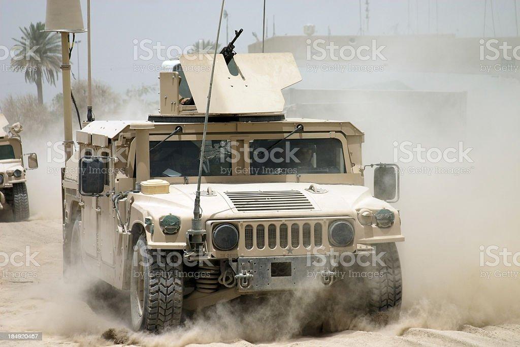 Desert war armored tanks going through sandy terrain stock photo