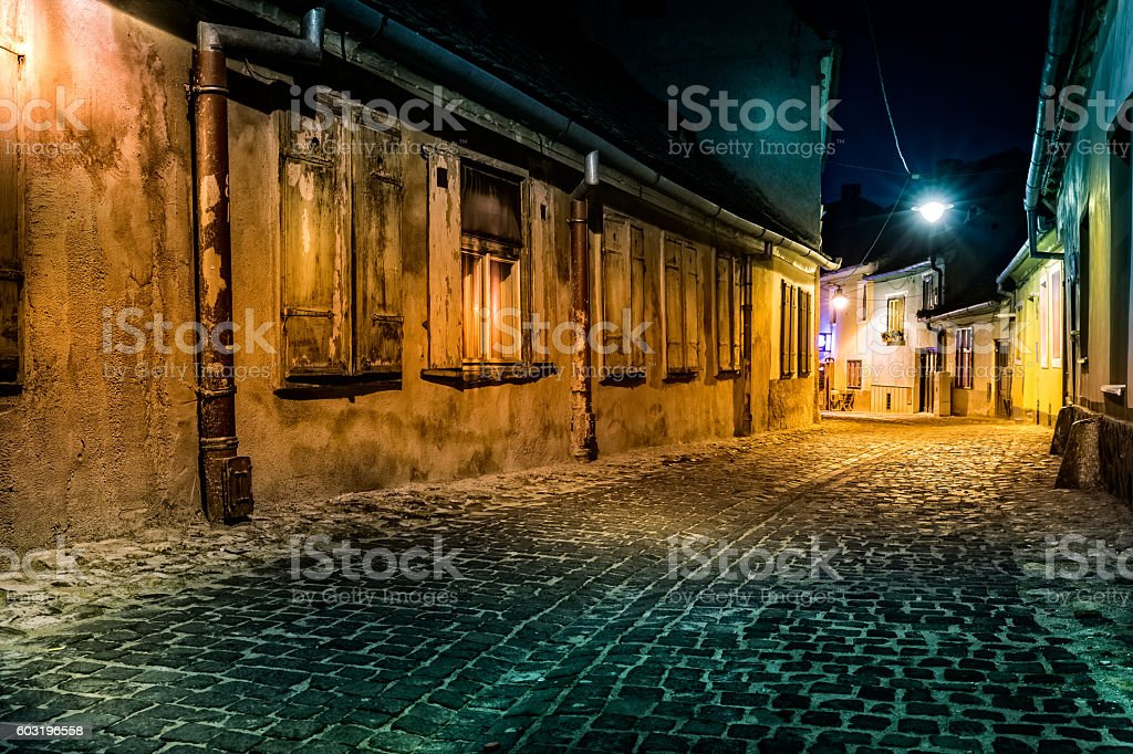 Deserted alley by night, in Sibiu, Romania stock photo