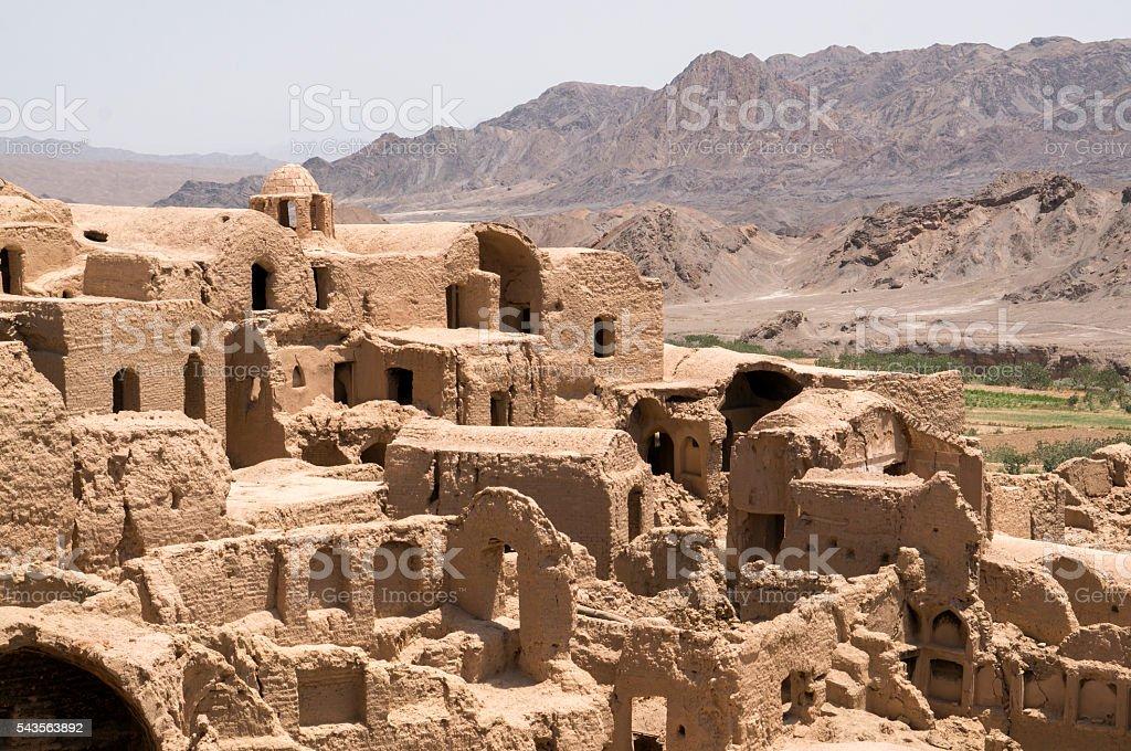 Deserted and crumbling mud-brick village of Kharanaq, Iran stock photo