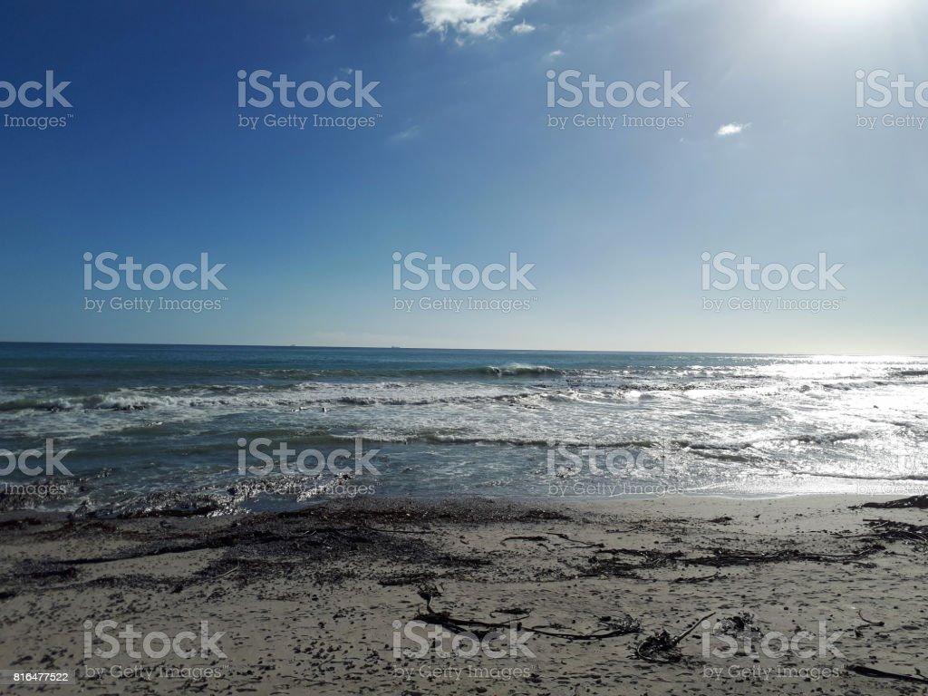 A deserted beach at dusk stock photo