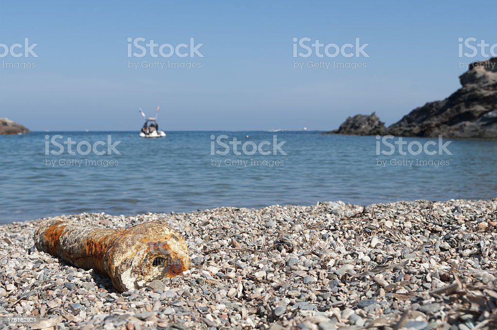 Deserted beach with boat in distance royalty-free stock photo