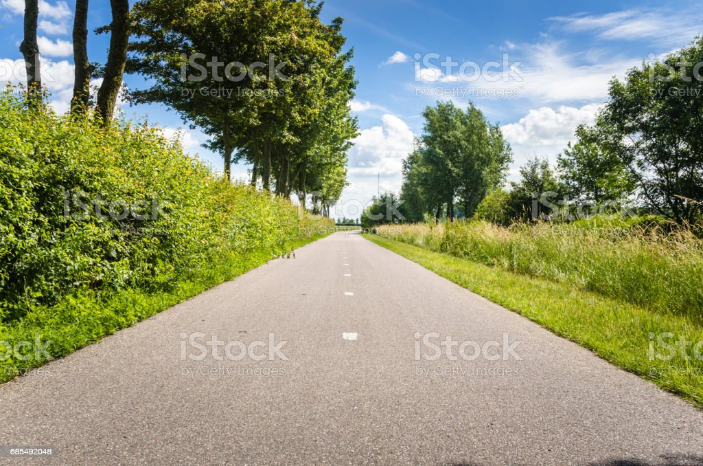 Deserted Bicycle Path and Blue Sky stock photo