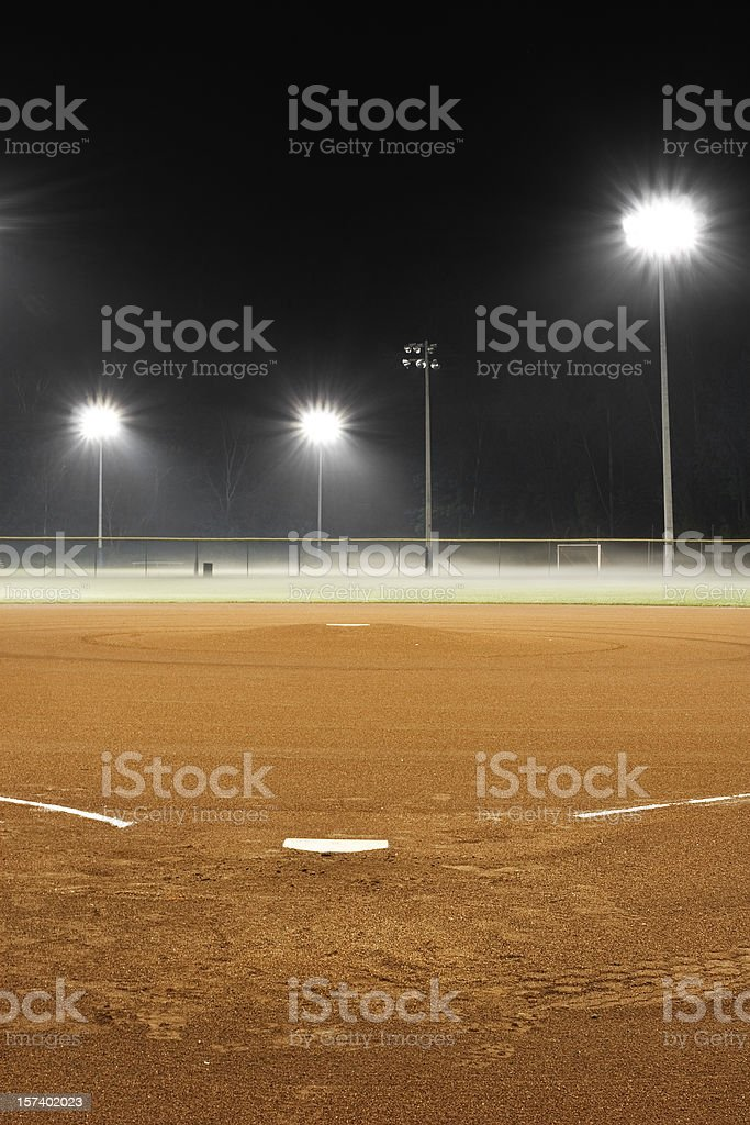 Deserted, Brightly-lit, Baseball Diamond at Night stock photo
