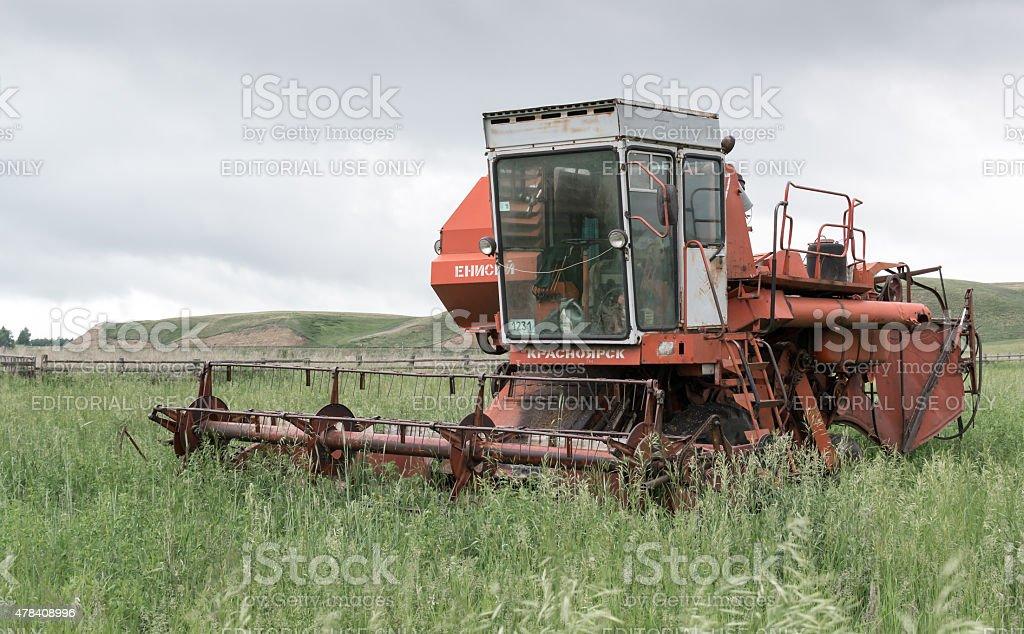 Deserted Broken Russian Soviet Red Harvester stock photo