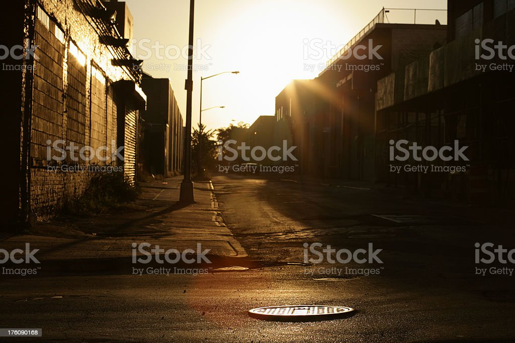 Deserted Brooklyn Backstreet at Sunrise Lens Flare royalty-free stock photo