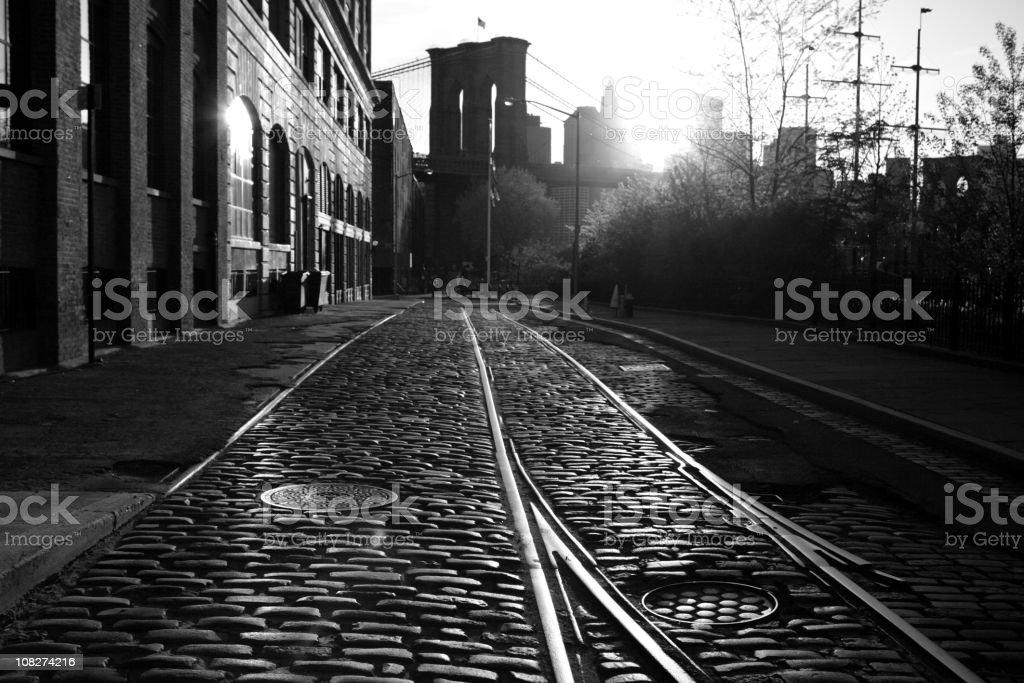 Deserted Brooklyn Bridge Waterfront Sunset Monochrome royalty-free stock photo