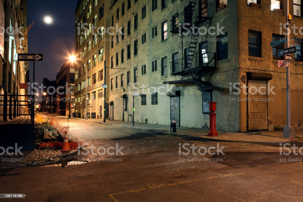 Deserted Brooklyn DUMBO Cobblestone Backstreet at Night Full Moon royalty-free stock photo