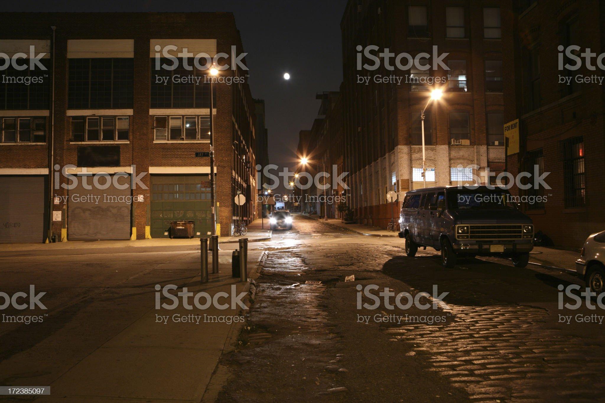 Deserted Brooklyn DUMBO Cobblestone Backstreet at Night Full Moon royalty-free stock photo