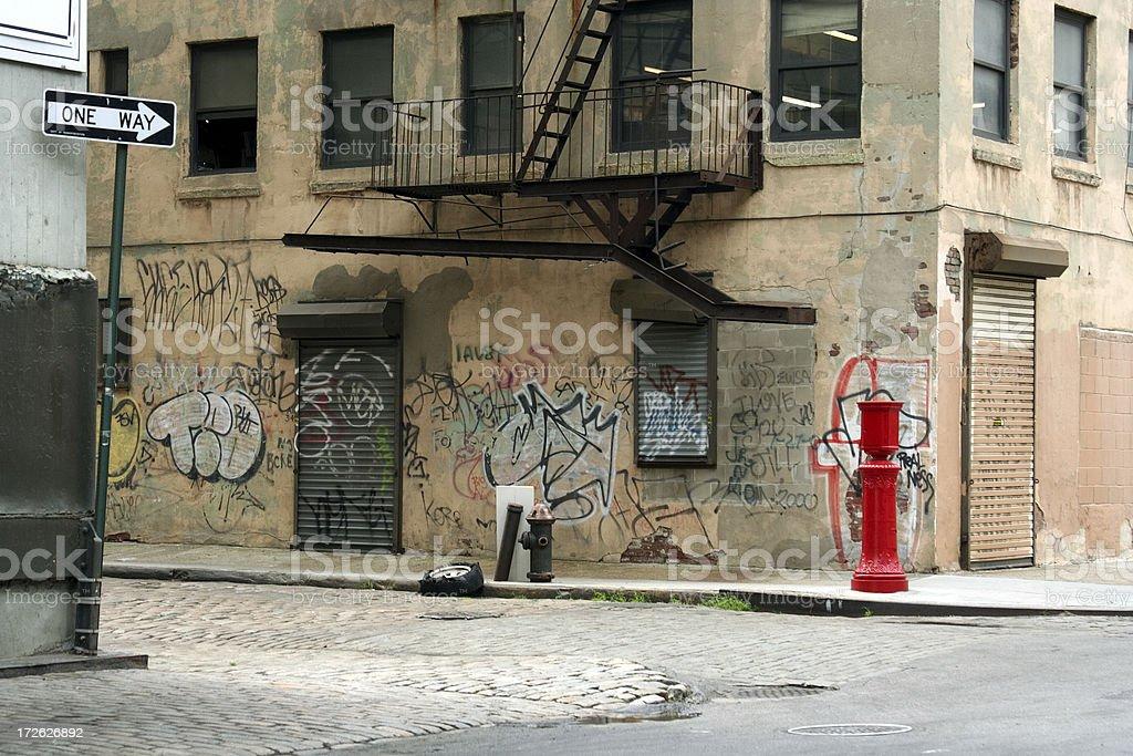 Deserted Brooklyn DUMBO Cobblestone Backstreet with Graffiti stock photo